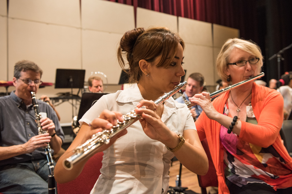 A student from the national youth symphony sits right next to flutist Wendy Williams, as part of a side by side rehearsal, where orchestra members paired up with members of the youth symphony for a rehearsal conducted by Osmo Vanska.