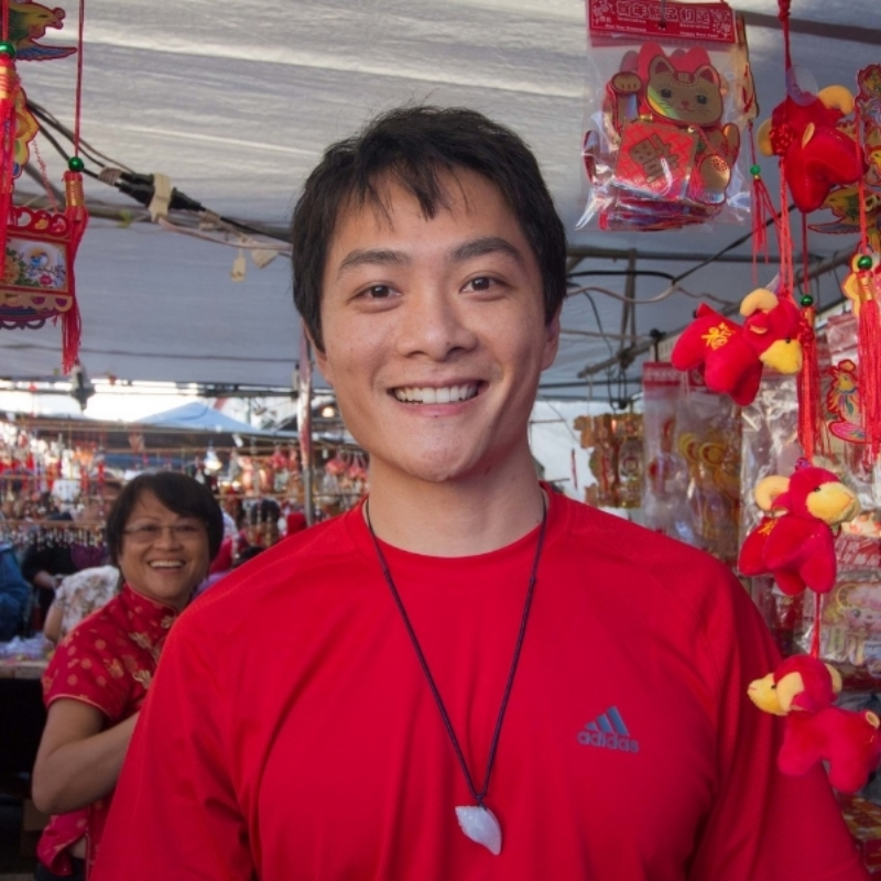 Ernest Tsang at the Chinatown Block Party with his mom Stella Tsang in the background.