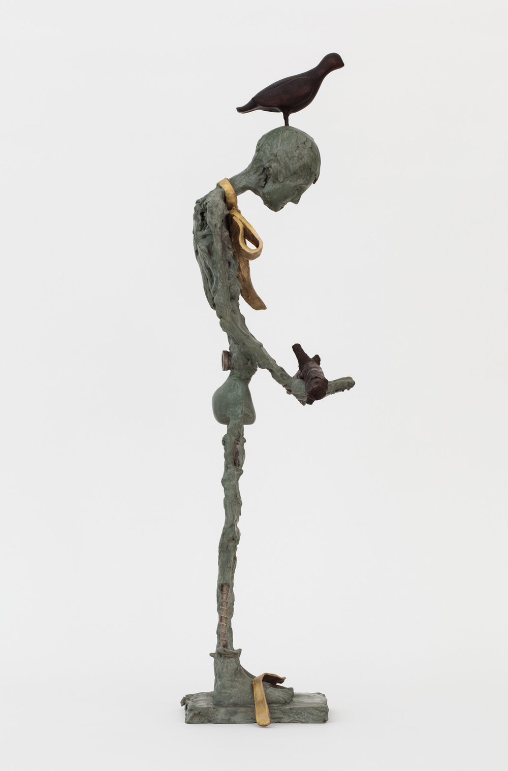 Untitled Figure with Gold Bow