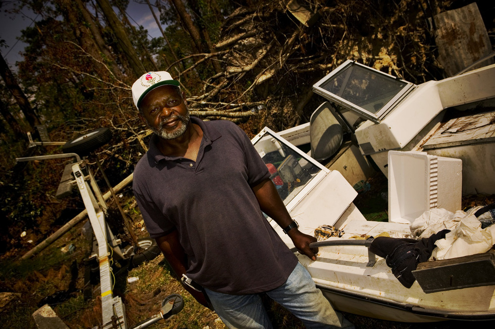 James Peters, 58, Pearlington, Mississippi. He stands next to the boat he used to save the lives of thirteen people from the floodwaters.
