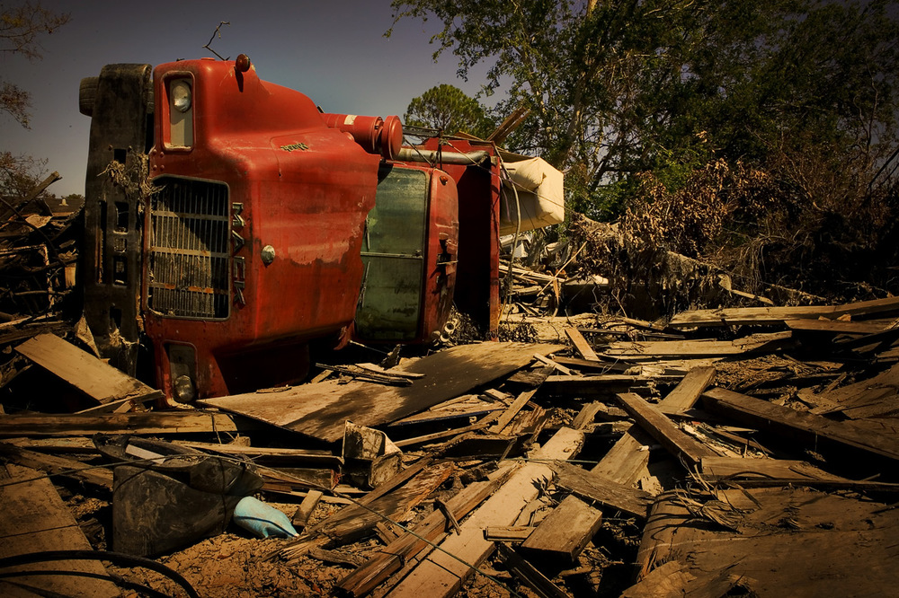 A Mack truck rests on its side in someone's yard in the Lower Ninth Ward, New Orleans