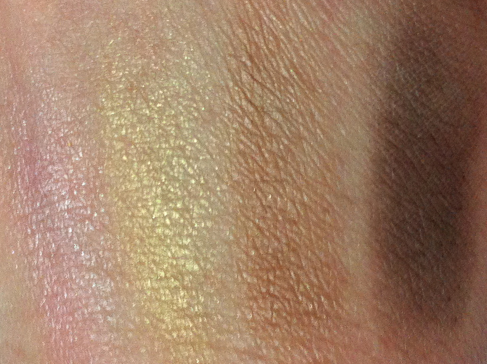 MAC's Caramel Sundae eyeshadow palette swatched on my NC/NW 15–20 skin. Left to right: Cheryl Chic (frost), Dreammaker (frost), Caramel Sundae (satin), and Showstopper (matte).