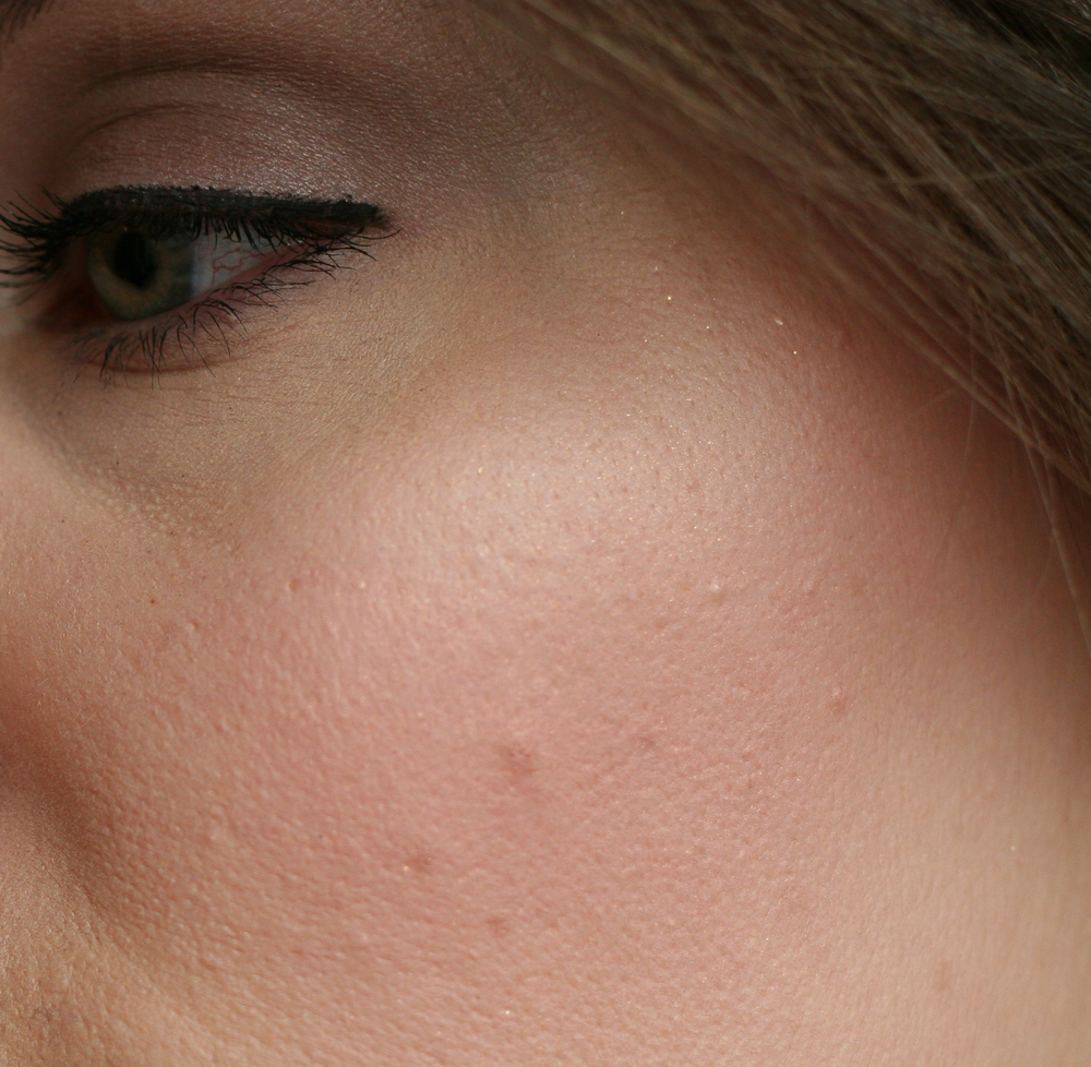 A close-up of NARS blush in Super Orgasm applied lightly—pores and all. (Brave, right?)As you can see, I've blended most of the glitter away, missing just a few specks up at the top, near my hairline.