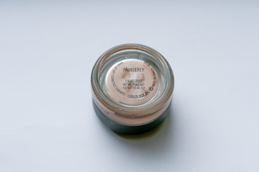 MAC Paint Pot in Painterly, from the underside. You can see the colour through the clear glass bottom.