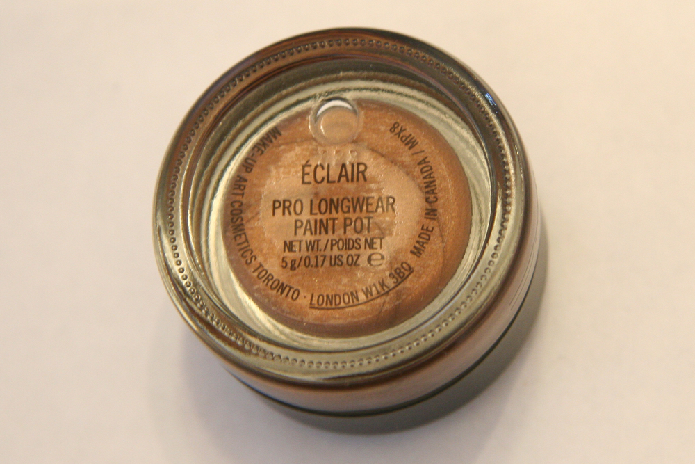 MAC Pro Longwear Paint Pot in Eclair. It comes in a sturdy glass jar, and you get five grams of product.
