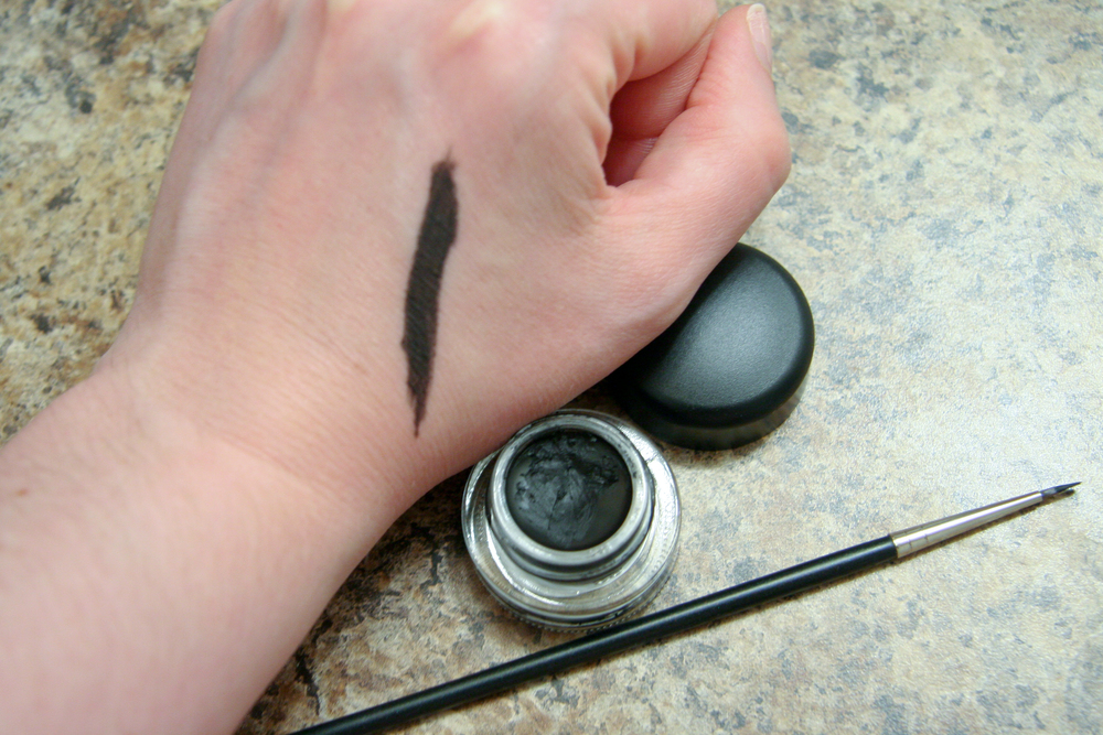 MAC Fluidline in Blacktrack swatched very, very heavily with a MAC 210 brush.