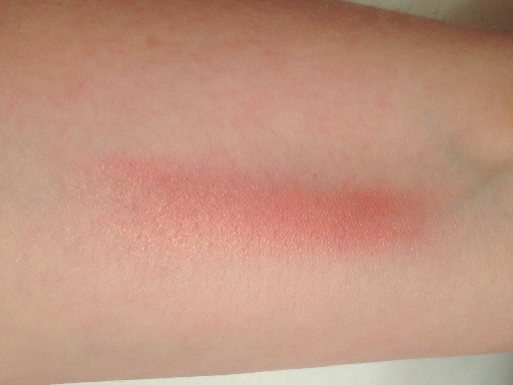 Clinique Blushing Blush Powder in Precious Posy swatched on my arm.