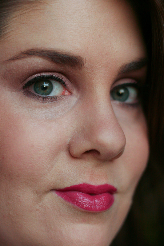 Illamasqua Intense Lipgloss in Belladonna applied. For reference, I'm about an NW20 (fair with rosy undertones), and this photo was taken in natural light.