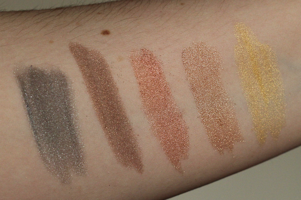 Swatches of Styli-Style Dramatic Dip Loose Eyeshadow. Left to right: Thunderhead, Rain Cloud, Tempest, Meteor Strike, and Sunshine.