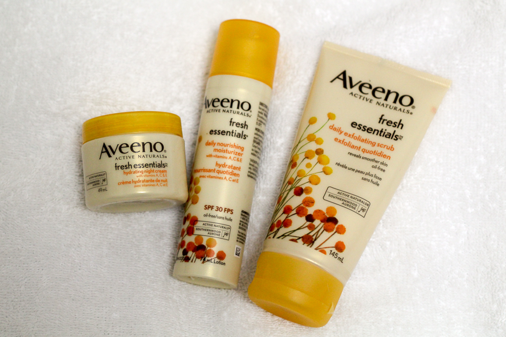 Aveeno Fresh Essentials hydrating night cream, daily nourishing moisturizer, and daily exfoliating scrub.