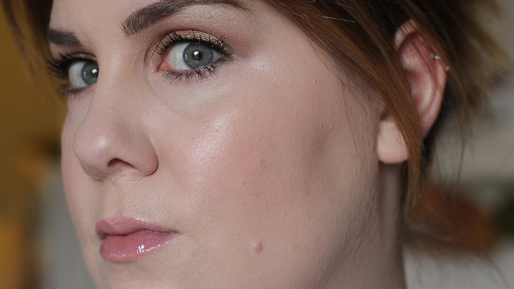 Here, I've added a bit of the peachy blush shade and a bit of the highlighting shades, and blended everything out with my fingers and a Beauty Blender.