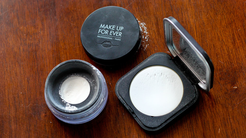 Make Up For Ever's new Ultra HD Microfinishing Powders, loose (L) and pressed.