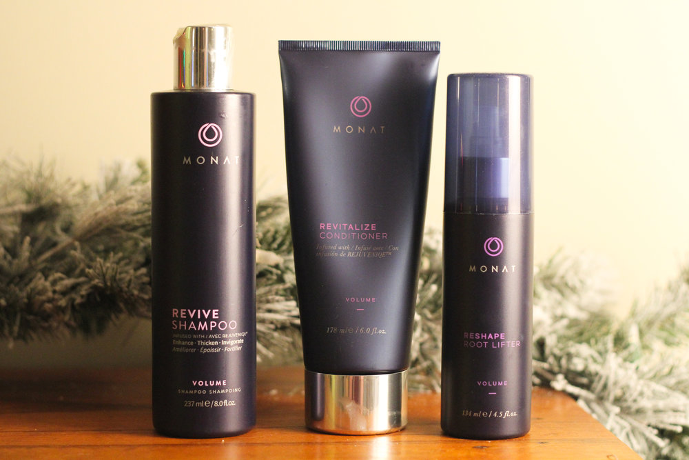 MONAT's Volume System, which consists of Revive Shampoo, Revitalize Conditioner, and Reshape Root Lifter.