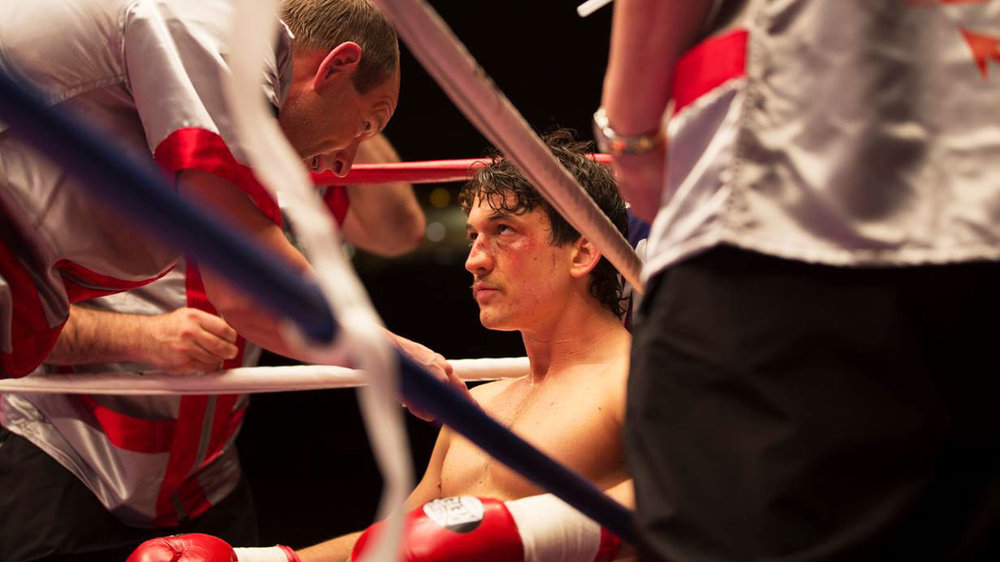 Aaron Eckhart and Miles Teller in a scene from Ben Younger's  Bleed for This  {Photo: OPEN ROAD}