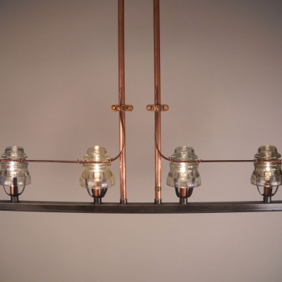 Repurposed light fixture by Conant Metal & Light - the use of copper pipes as electric carrier and old insulator glass makes this a delicate and beautiful recycle piece of art [ I used this one with some customization at Catch restaurant over the communal table ]