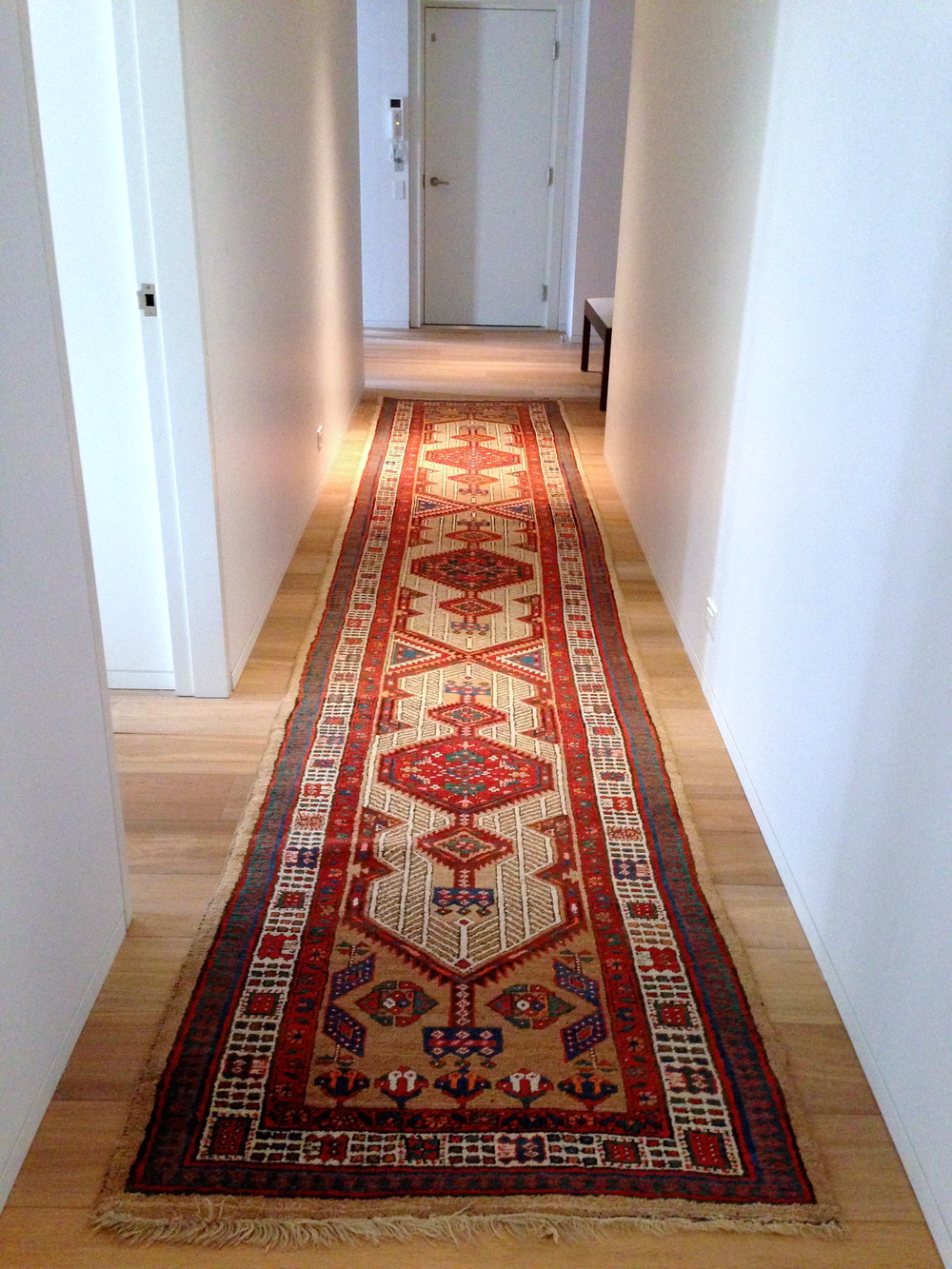 "Sarab Wool in client's home as a runner 3'-0"" x 17'-0""   This fits the warm oak wood floor and bring colors into the long corridor."