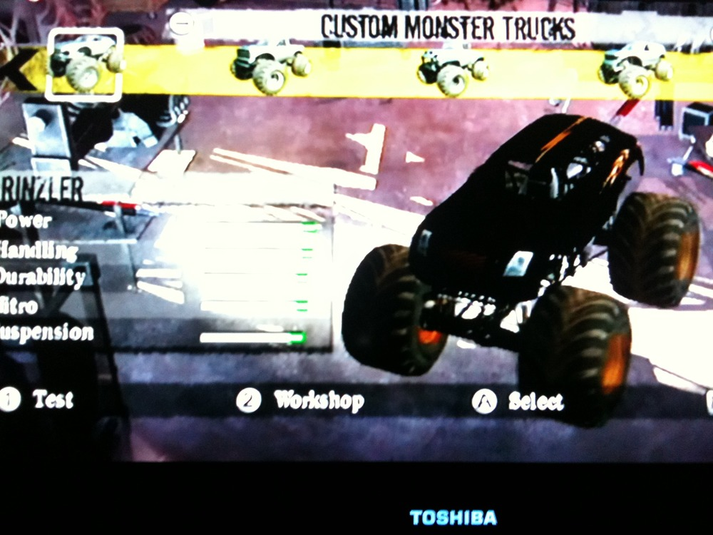 The boy customized some Monster Jam trucks: Rinzler, Tron, and C.L.U.