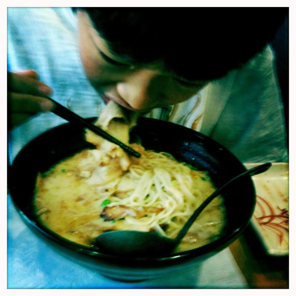 Instead of seafood ramen, the boy opted for a whole bowl of baby octopus.