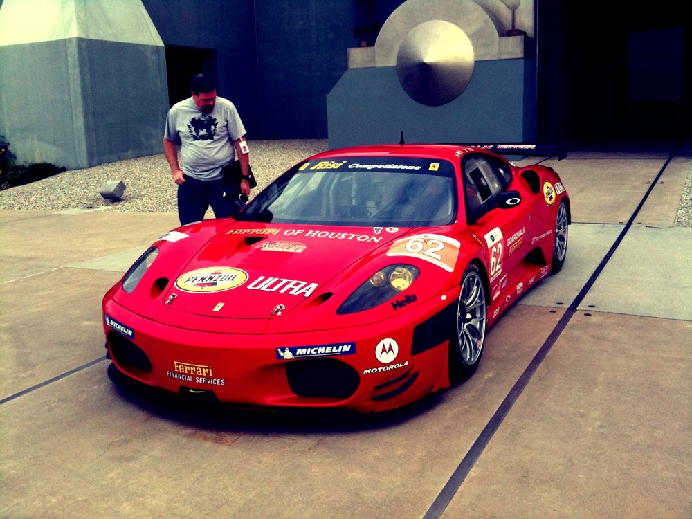 Photos and video of Team Risi Competizione demonstrating pit stops and donuts with their Ferrari F430 at Oakley HQ.