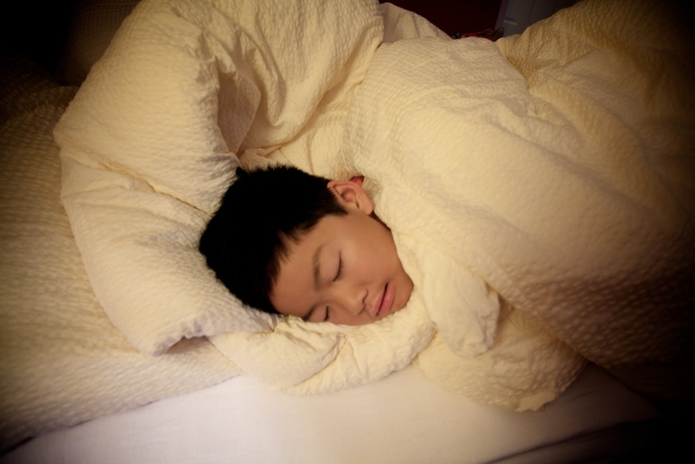 Day 6: The boy loves comforters. Looks like he's sleeping in the clouds.