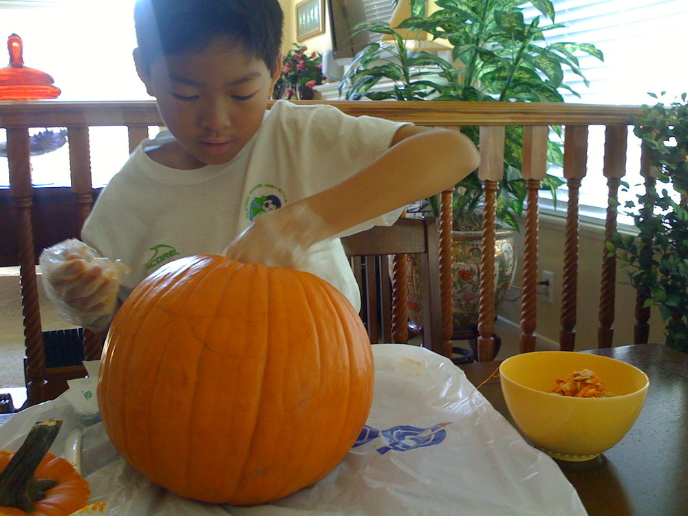 Carving the Kidreaper-inspired pumpkin