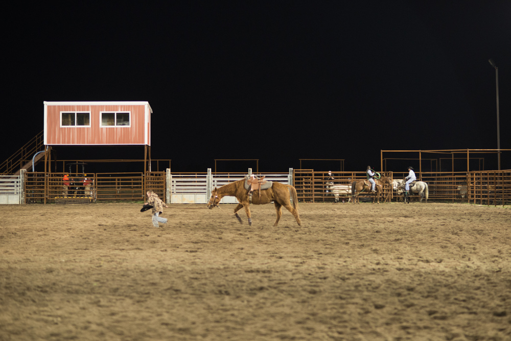 A young boy leads his horse at weekly Cattle Roping at the Cowboy Church near Whitewright, North Texas.