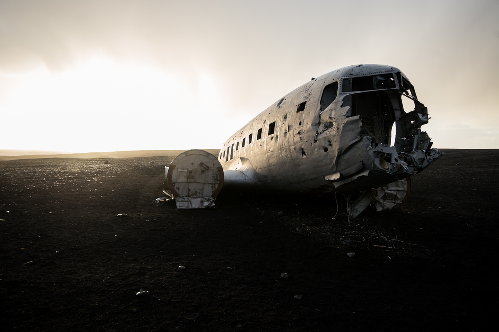 This US Navy plane that crashed in 1973, with no casualties, in the middle of miles and miles of black sand beach, is downright one of the most surreal places I've ever been