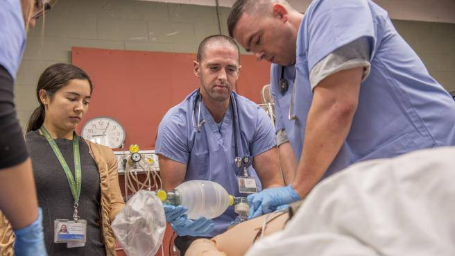 Fourth-year resident, Dr. Samantha Jang-Stewart (left), participates in a simulation training exercise at the Simulation Bay at the QEII Health Sciences Centre. (RPM Productions)