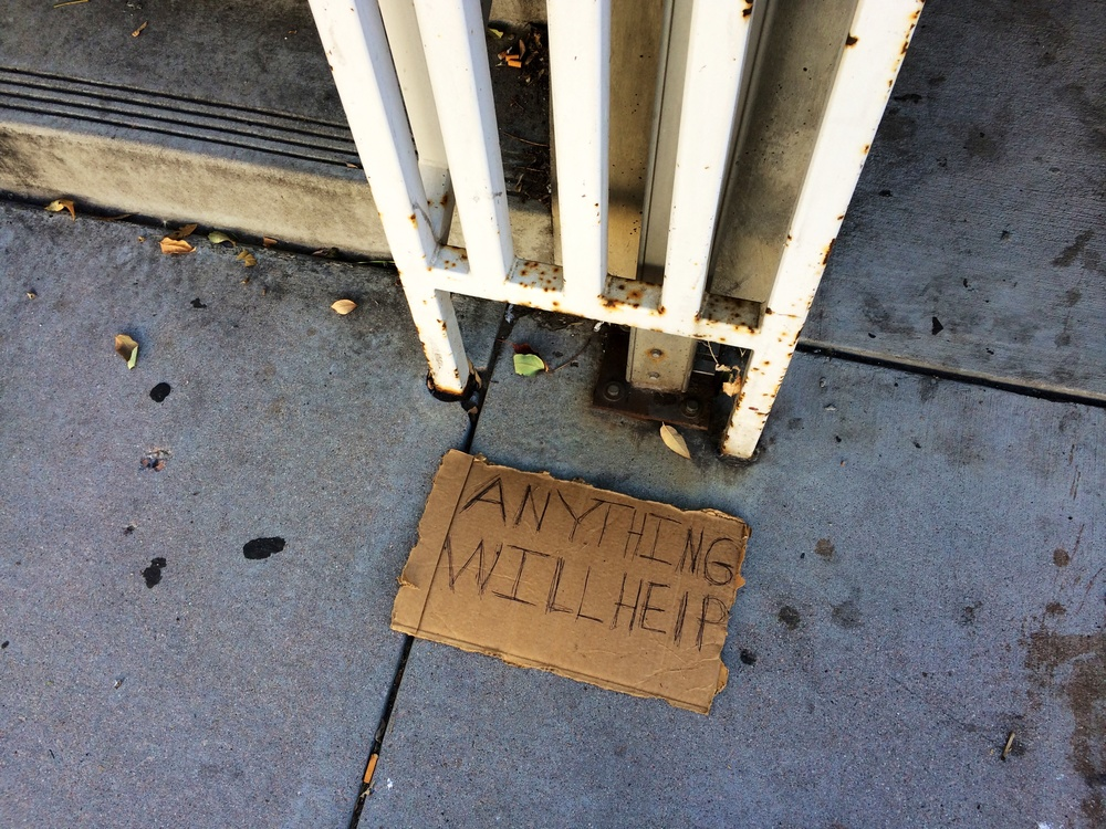 Anything indeed. This sign was lying on the sidewalk on my walk to the clinic.