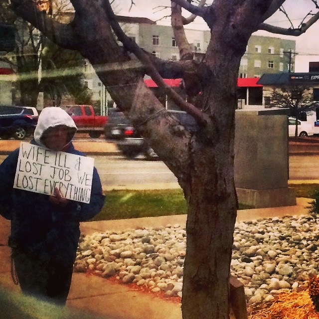 Panhandling must be one of the hardest jobs - A man holds a sign on Colorado Blvd in Denver.