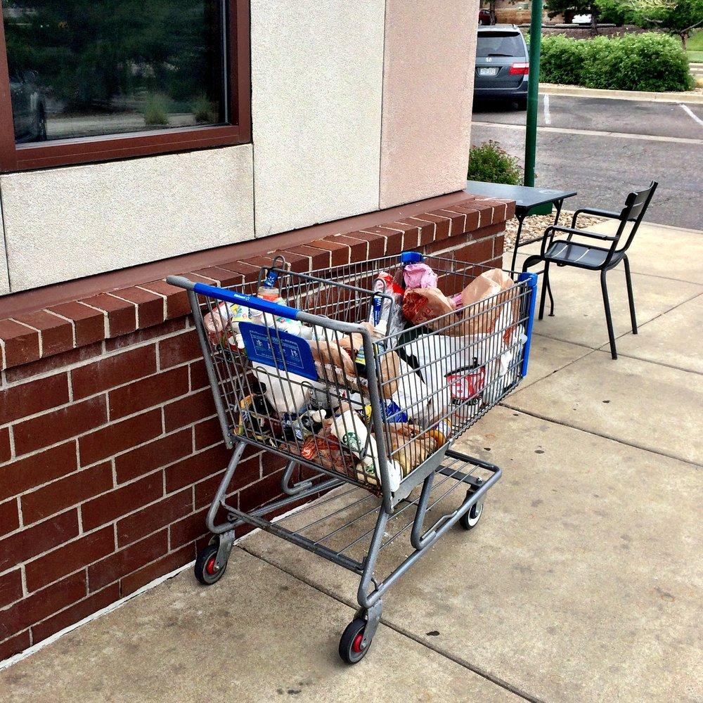 A Wal-Mart Shopping Cart Parked at Starbucks