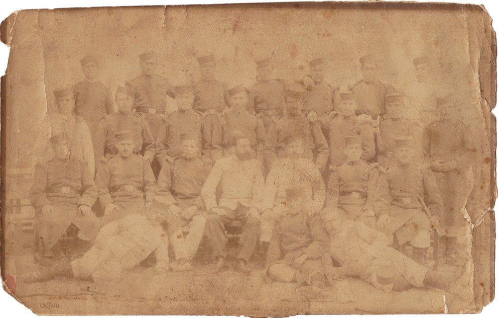 Grandfather Estanislao de Llano is one of the men doing military service in this faded photograph.
