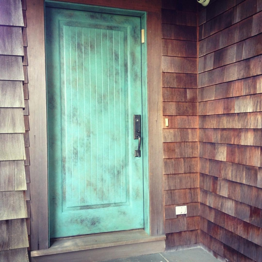 Faux verdigris door