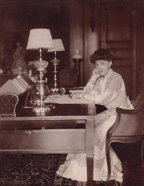 "Edith Wharton, author of the Pulitzer Prize winning novel ""The Age of Innocence"", seated at her desk in her library at The Mount, circa 1905"