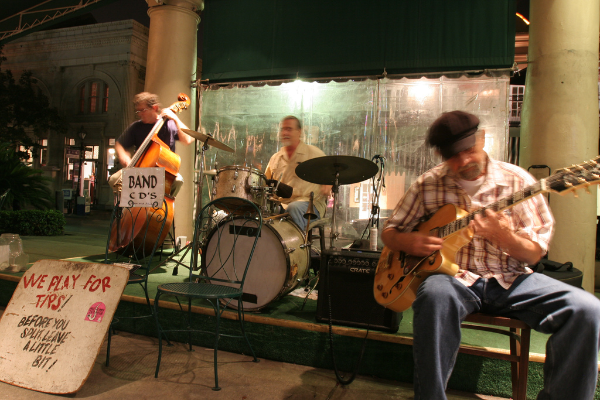 A band performs (and sells CDs) on the streets of New Orleans. (Photo Credit: flickr/Barrett Aspach)