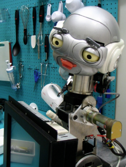 A robot programmed to give verbal assistance during a baking task.