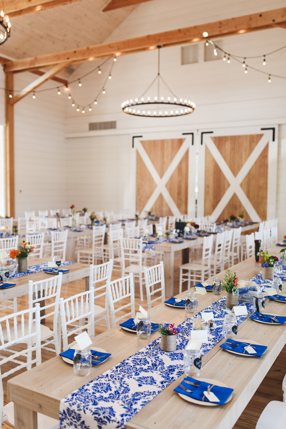 Long table and interior of venue at the Barn at Smuggs, Jeffersonville, VT