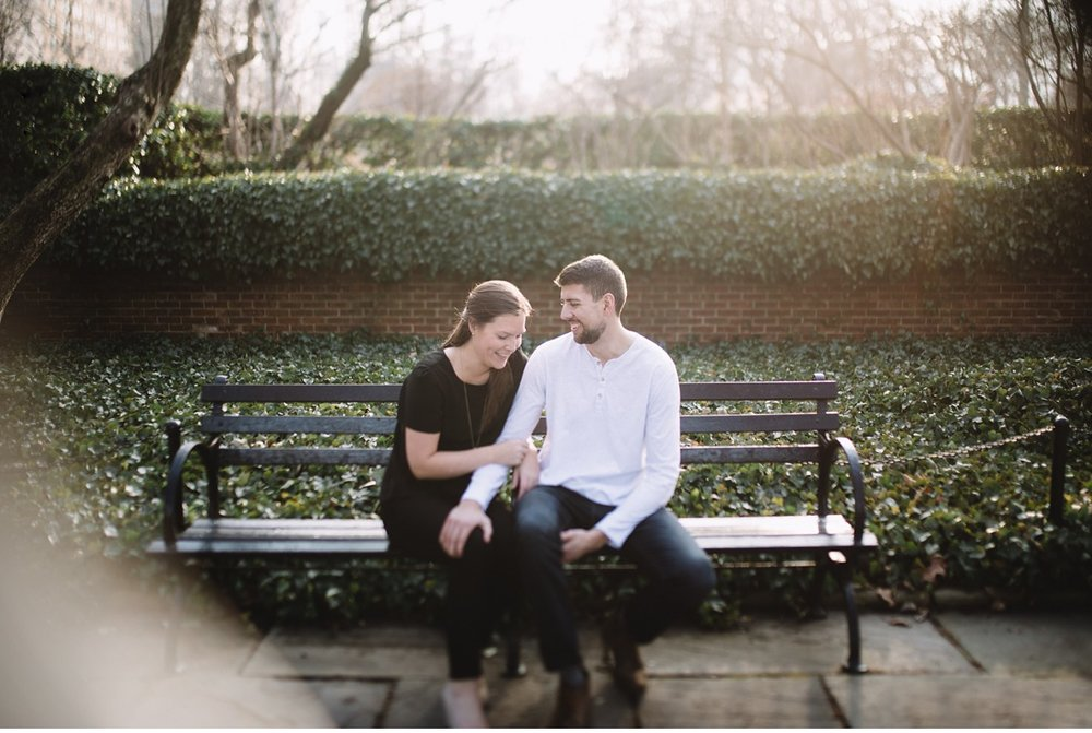 Artistic candid photo of engaged couple in Conservatory Garden, NYC