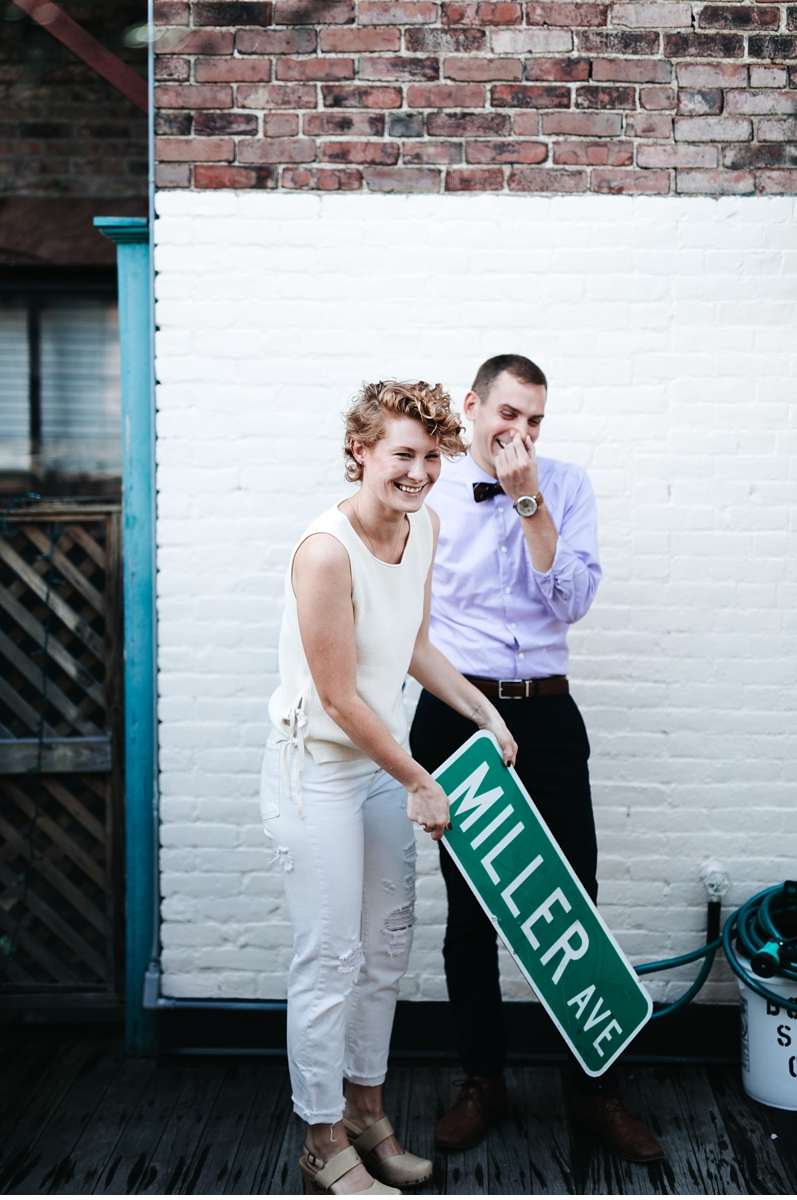 couple with custom sign during engagement session Boston MA