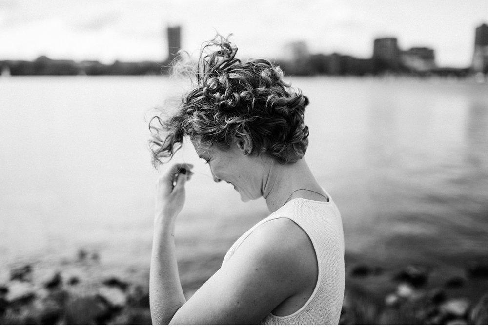 portrait of woman near river in Boston
