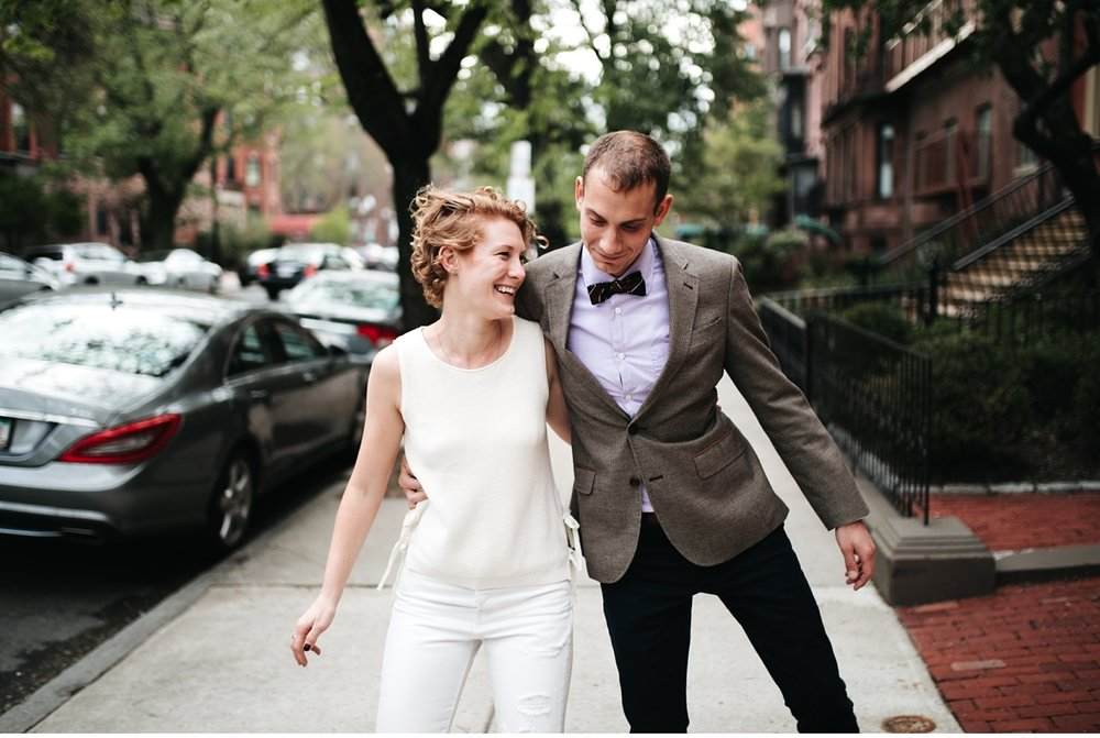 Playful couple on Beacon St in Boston MA for engagement session