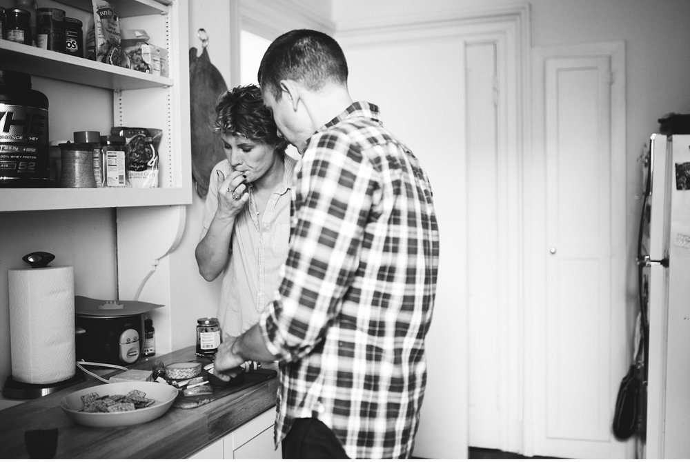 couple making snacks together in kitchen in Boston MA