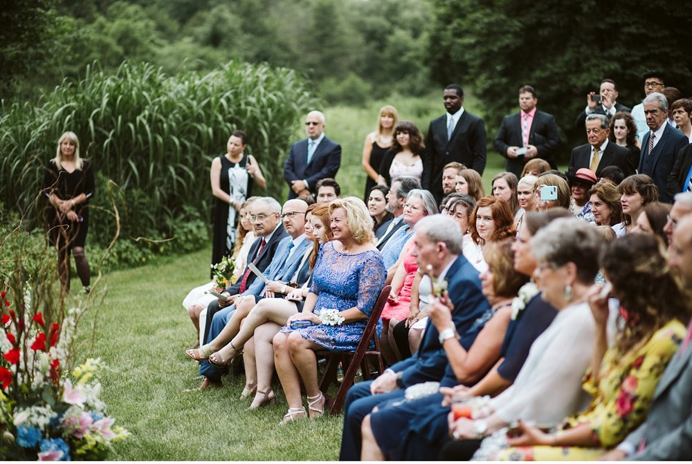Guests at outdoor ceremony during Willowwood Arboretum wedding
