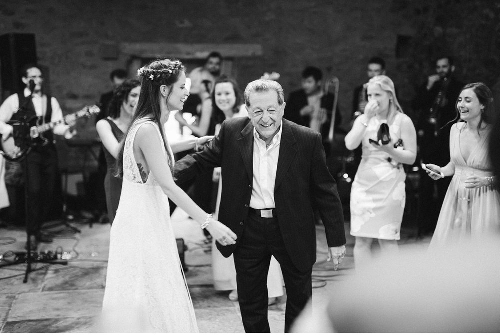 Bride dancing with grandfather in stone barn at Willowwood Arboretum