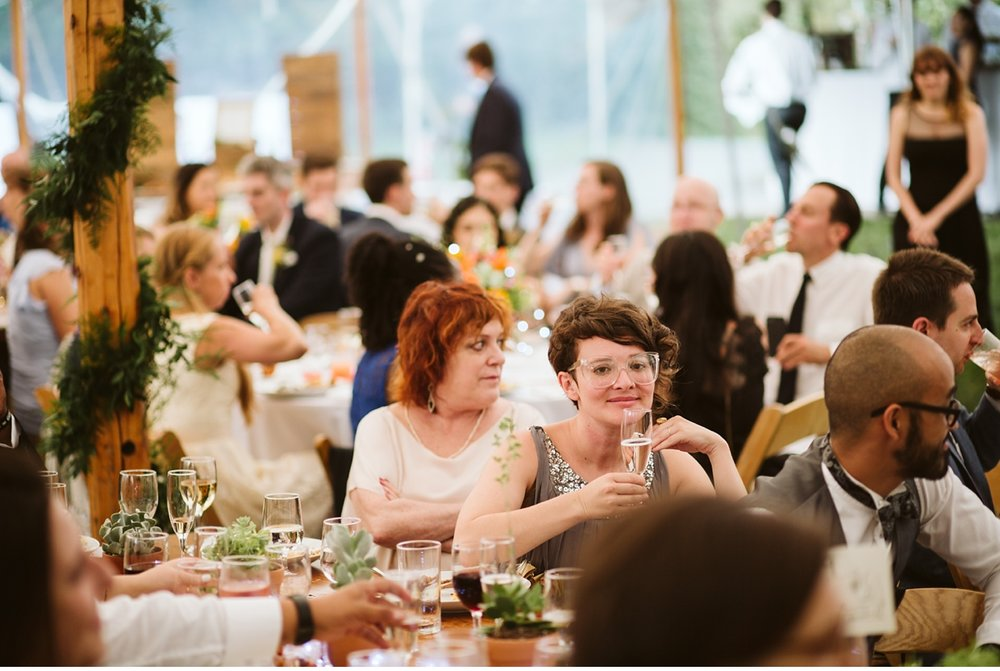 Candid of guest at tented dinner during summer wedding NJ