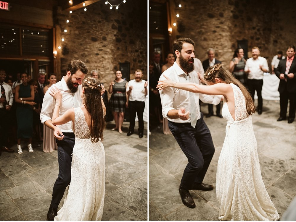 Bride and groom dancing in stone barn at Willowwood Arboretum