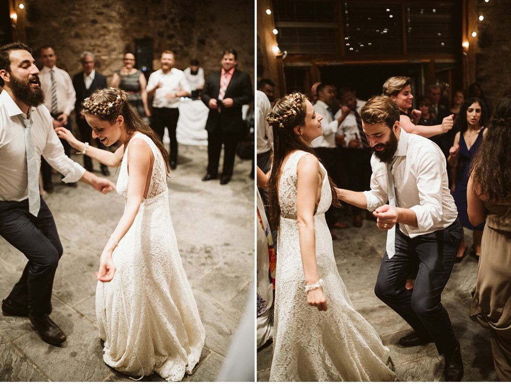 Bride and groom dancing in stone barn at Willowwood Arboretum-2
