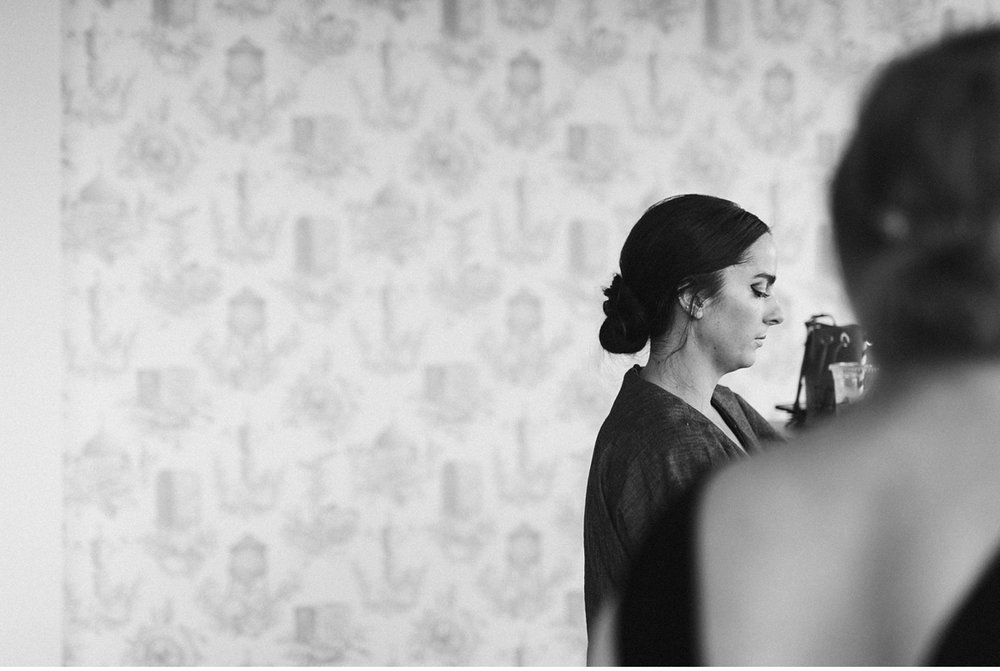 profile of bride in black and white while getting ready