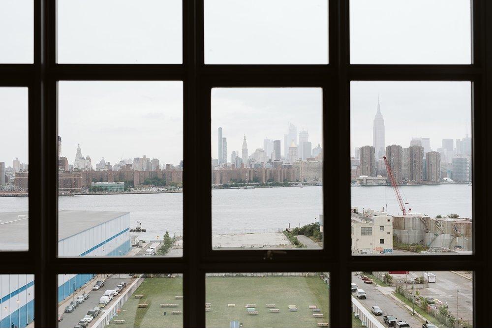 Manhattan skyline from hotel room at Wythe Hotel in Brooklyn