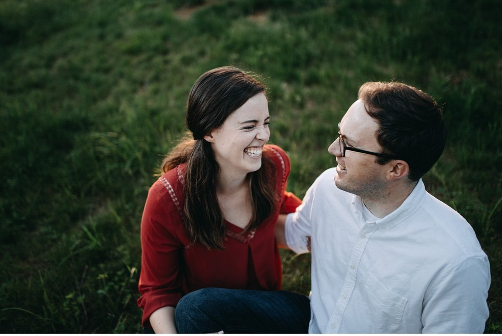 couple smiling and laughing in late afternoon